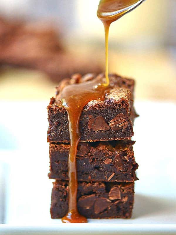 These flourless salted caramel brownies are gluten free, rich, fudgy, filled with salted caramel, and can be made ahead of time! showmetheyummy.com #glutenfree #flourless #brownies #chocolate #saltedcaramel #fudge
