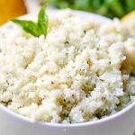 Lemon Garlic Cauliflower Rice. A healthy substitute for rice! It's naturally gluten free, vegetarian (can be vegan!), and so tasty! Full of fresh lemon juice, basil, garlic, and parmesan cheese. Less than 300 calories for the WHOLE recipe! showmetheyummy.com #glutenfree #healthy #vegetarian #vegan #lightenedup #cauliflower #fresh #rice