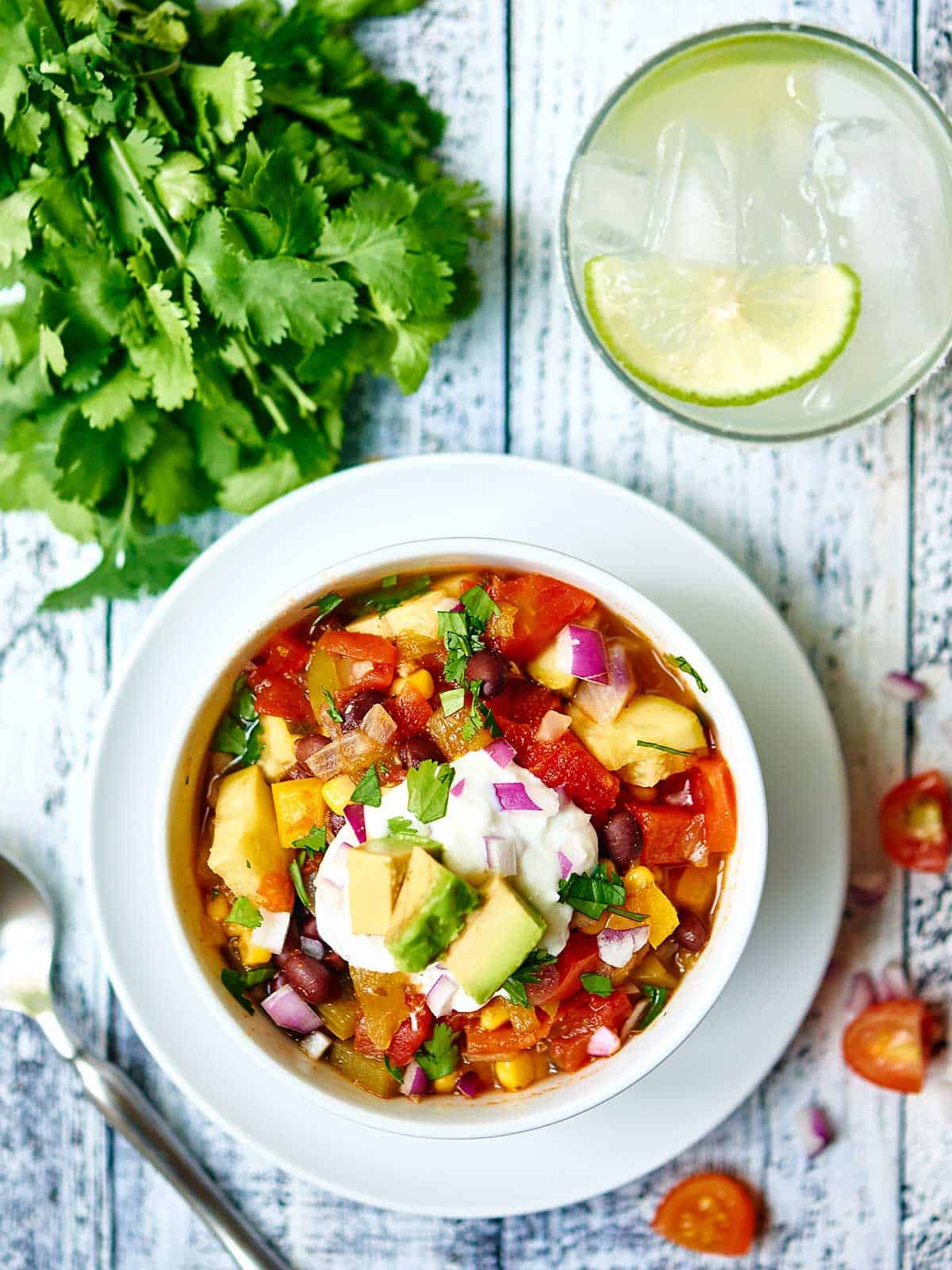 This Mexican Vegetable Soup is chock full of veggies, subtly spicy, and makes a ton! Make it today for Meatless Monday and enjoy it all week long! Less than 400 calories per serving! showmetheyummy.com #meatlessmonday #healthy #vegetarian #blackbeans #mexican #soup