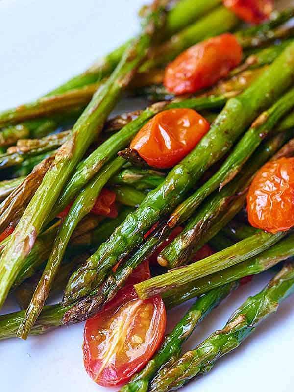 closeup of roasted asparagus and tomato