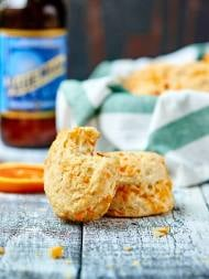 These roasted garlic cheddar beer biscuits are easy to make and totally sinful! A tender biscuit made with Blue Moon and stuffed with roasted garlic, shredded cheddar cheese, and rosemary. showmetheyummy.com #biscuits #vegetarian #beer #roastedgarlic #cheddar
