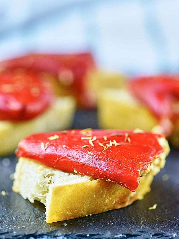 piece of bread with piquillo pepper on baking sheet