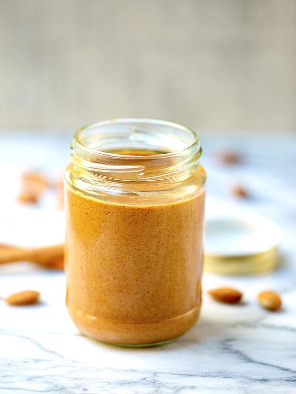 This homemade maple almond butter is so much better than store bought! I roast the almonds in maple syrup, which gives the butter a really rich flavor. I then stir in cinnamon and vanilla which adds so much warmth! Did I mention it's easy to make, vegan, and gluten free? showmetheyummy.com #almondbutter #almond #maple #cinnamon #vanilla #vegan #glutenfree