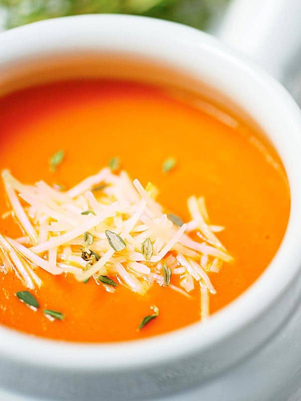 closeup of bowl of red pepper soup