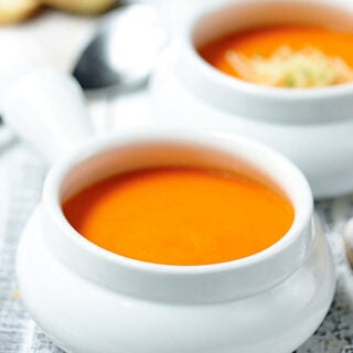 This roasted red pepper soup is easy to make, ultra creamy, gluten free, and can be vegan! It's healthy and so full of flavor. showmetheyummy.com #healthy #glutenfree #whitewine #thyme #spicy #soup #redpeppers #roastedvegetables #vitamix