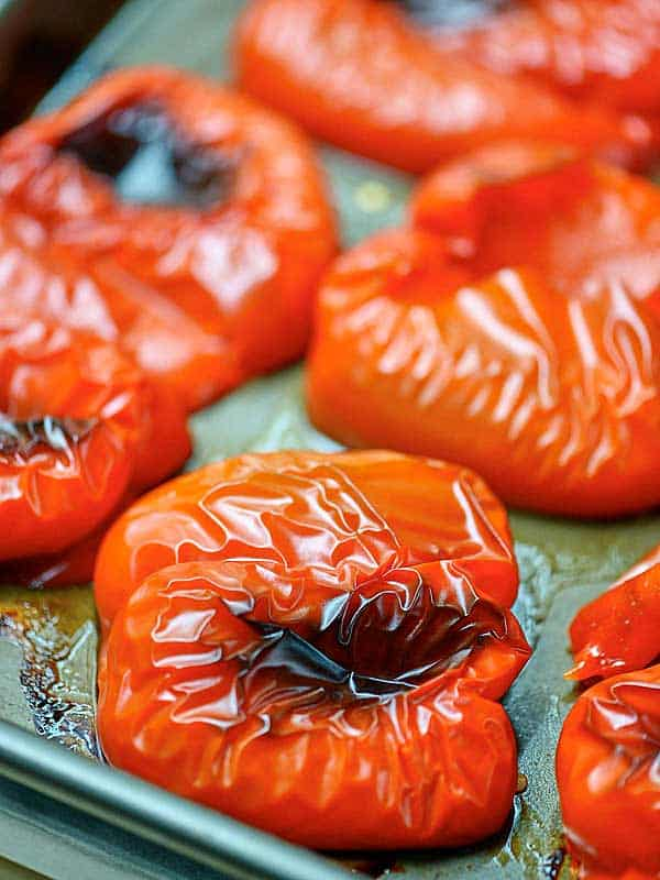 roasted red peppers on baking sheet