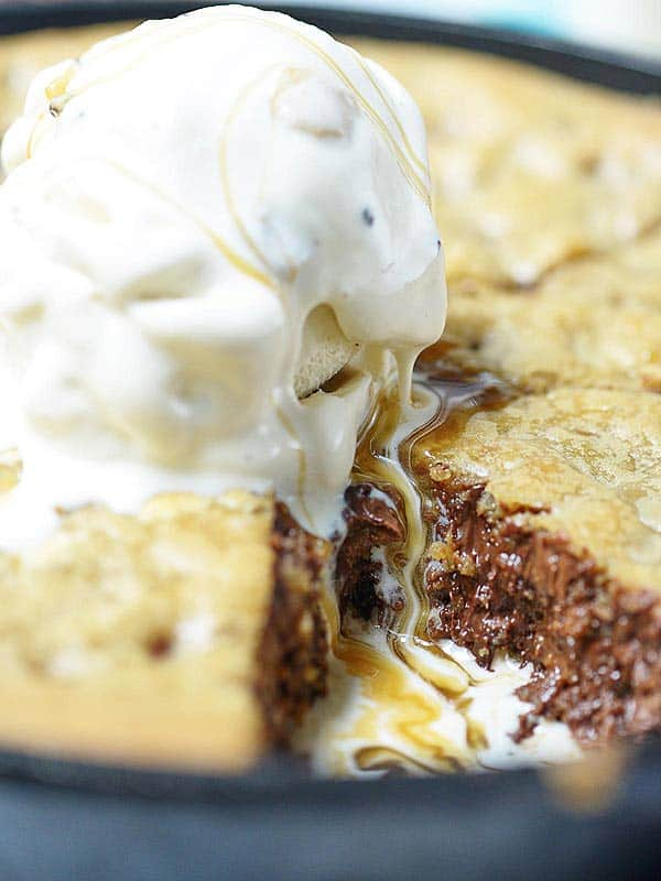 closeup of ice cream on chocolate chip cookie pie