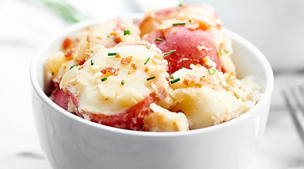 German Potato Salad. Creamy potatoes, crunchy, salty prosciutto, and that perfect tang from the vinegar makes this one of the best potato salads I've ever had! showmetheyummy.com #german #potato #salad #bbq #prosciutto #grilling #sidedish
