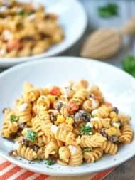 This Mexican Pasta Salad needs to make an appearance at your next grill out. A fun textured pasta + fresh crunchy veggies + black beans + a kick butt sauce! showmetheyummy.com #mexicanfood #pasta #salad #mexicanpastasalad #pastasalad #grilling #sidedish #vegetarian