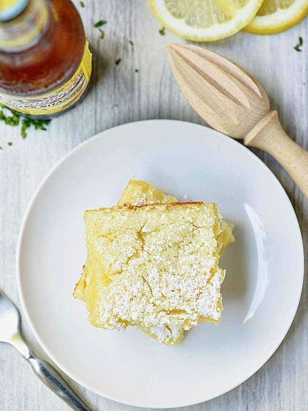 two lemon bars stacked on plate above