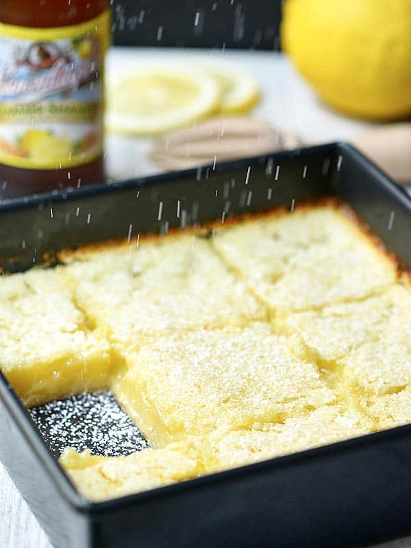 baking pan of lemon bars one taken out