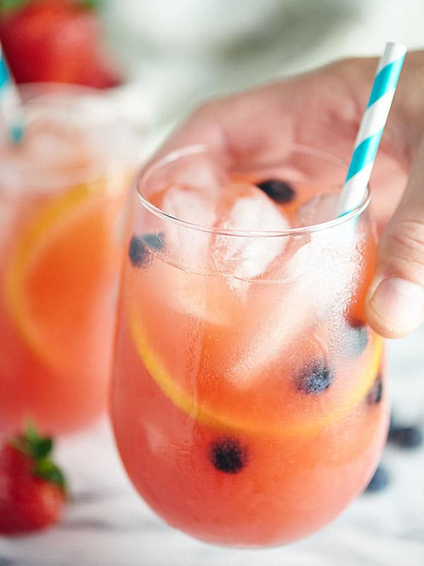 glass of watermelon sangria held