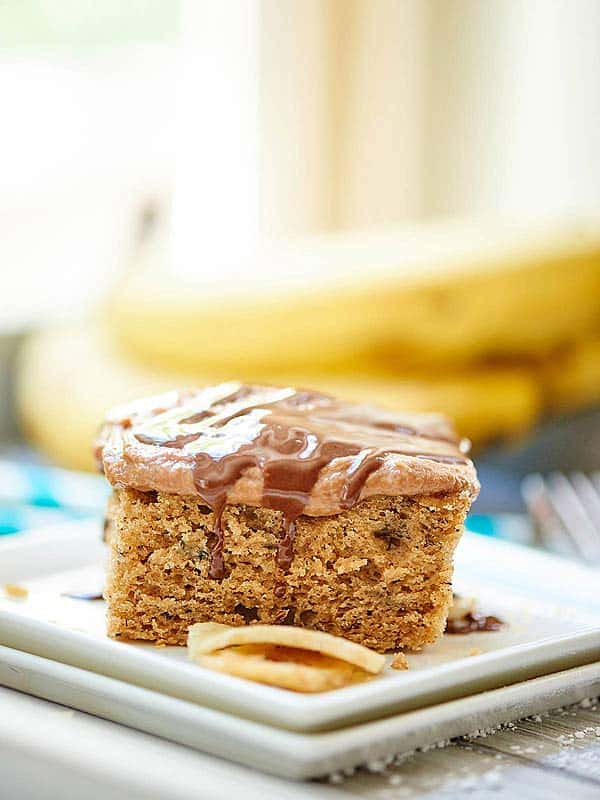 Chocolate Peanut Butter Banana Cake - Moist banana cake topped with creamy, fluffy, super peanut buttery, chocolatey cream cheese frosting. showmetheyummy.com #cake #frosting