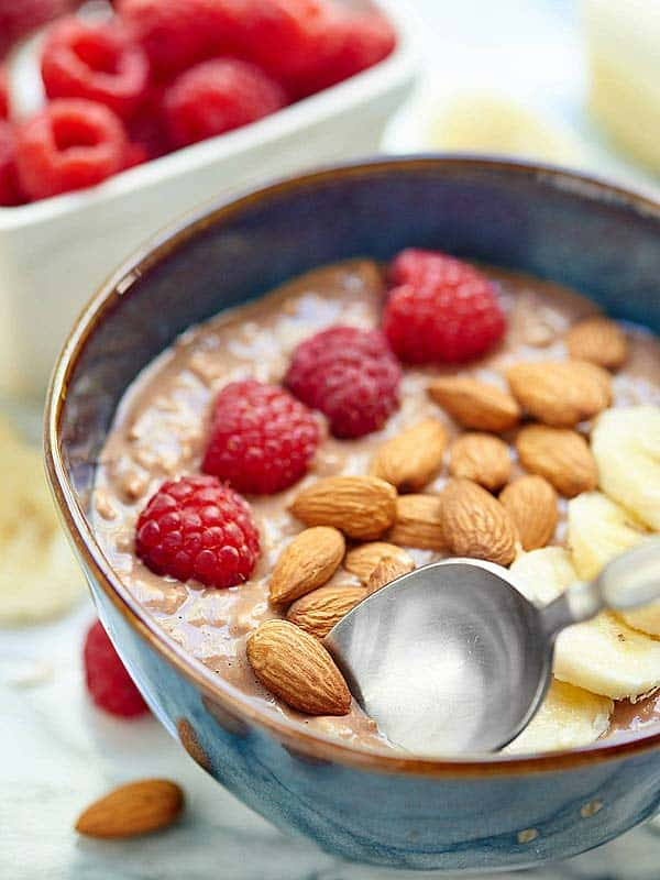 These Chocolate Peanut Butter Jelly Overnight Oats can be made in advance, are easy to make, are filled with chocolate and peanut butter, AND are healthy! Count. Me. In. showmetheyummy.com #chocolate #oatmeal #peanutbutter #fruit #healthy #glutenfree #vegetarian #breakfast