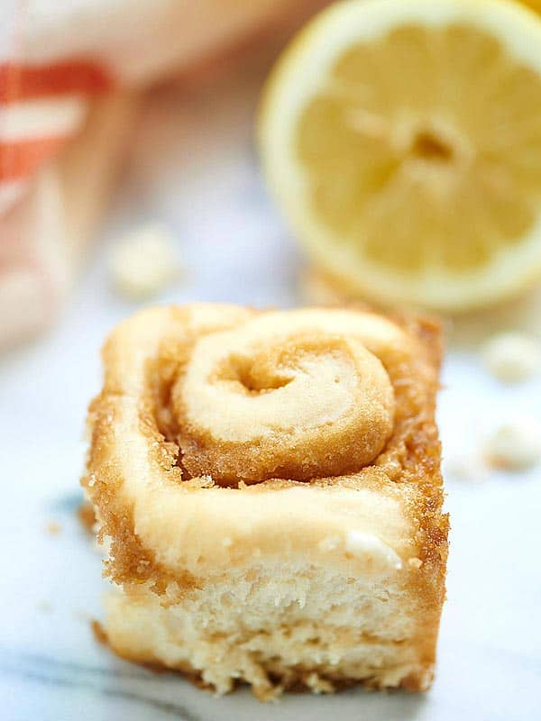 Coconut Lemon Sweet Rolls w/ a White Chocolate Coconut Lemon Cream Cheese Frosting. The perfect, summery breakfast! showmetheyummy.com #breakfast #baking