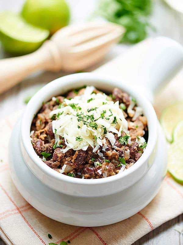 Bowl of black beans with cheese