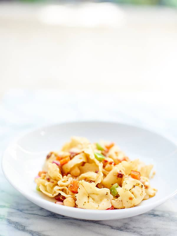 This Greek Tortellini Pasta Salad is vegetarian, easy, and so tasty! Sun dried tomatoes. Salty feta. Chickpeas. Fresh vegetables. Cheese Pasta. Yes please! showmetheyummy.com #pasta #vegetarian