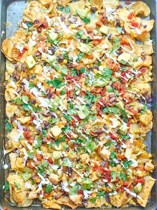 kettle chip chicken nachos on baking sheet above