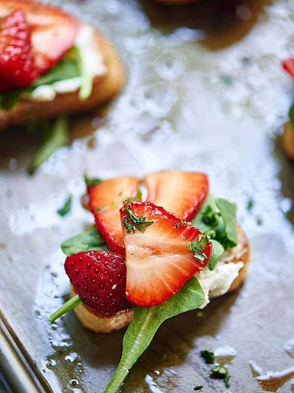 piece of strawberry goat cheese bruschetta