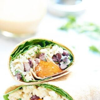 This healthy sweet potato wrap is hearty, vegetarian & full of good for you ingredients like black beans, brown rice & is drizzled in a unique tahini sauce! showmetheyummy.com