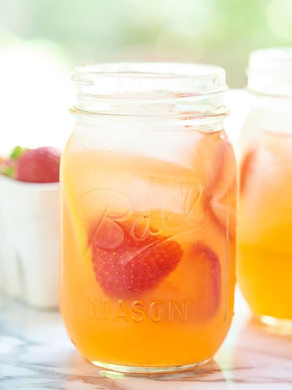 This honey strawberry lemonade only has four ingredients and is naturally sweetened! Perfect for kids! Add a shot of gin for an adults only cocktail! showmetheyummy.com #honey #lemonade