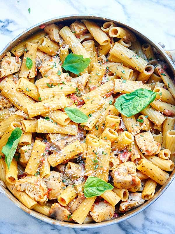 This one pot pasta is full of creamy goat cheese, meaty mushrooms, and juicy chicken! It only requires dirtying one dish and takes less than 30 minutes! showmetheyummy.com #pasta #chicken