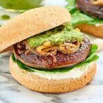 This Portobello Mushroom Burger is vegetarian, healthy, can be gluten free, and is topped with caramelized onions, a homemade basil pesto, and goat cheese! showmetheyummy.com #vegetarian #burger