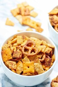 Chex mix that's made in the crockpot?! Yes please! This slow cooker chex mix is easy to make, flavored w/ ranch seasoning, & addicting! You've been warned. showmetheyummy.com #slowcooker #chexmix