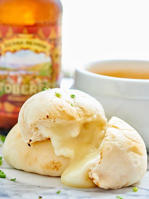 These Cheese Bombs with Beer Cheese Dip are a great, easy game day snack! Pillsbury biscuits are stuffed with cheese and paired with a beer cheese sauce! showmetheyummy.com #beer #cheese