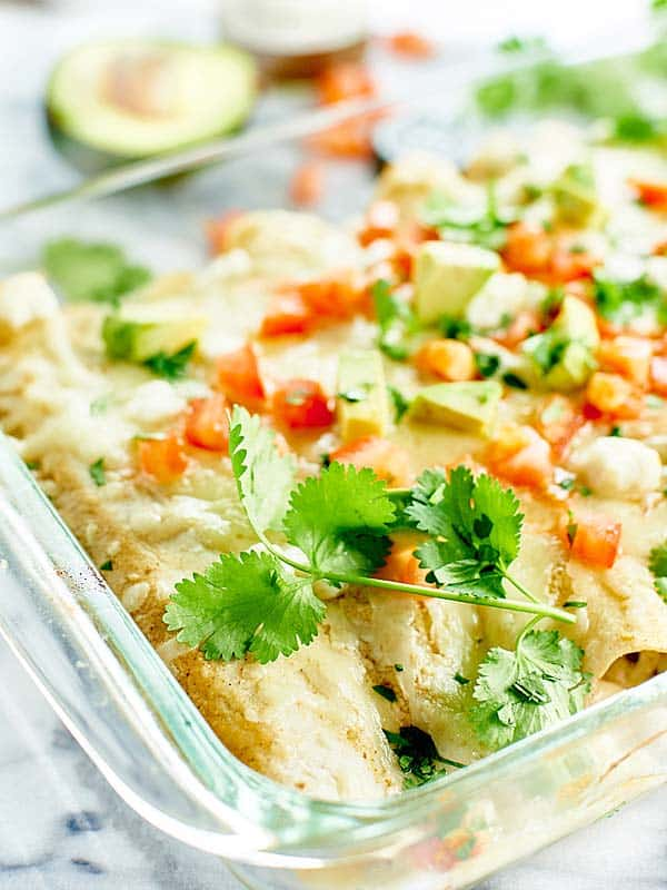 These Green Chile Chicken Enchiladas are stuffed w/ sweet potatoes, chicken, black beans, goat cheese, & Monterey jack cheese! We <3 easy dinner recipes! showmetheyummy.com #mexican #chicken