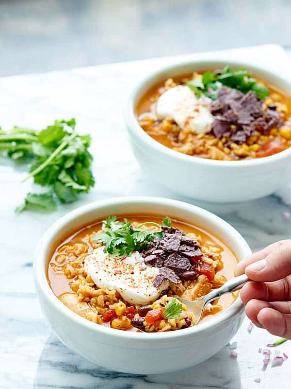 Cozy up with this One Pot Mexican Chicken and Rice Soup! It's healthy, hearty, and so full of flavor! Bonus: only ONE DISH and 5 minutes of prep necessary! showmetheyummy.com #soup #healthy