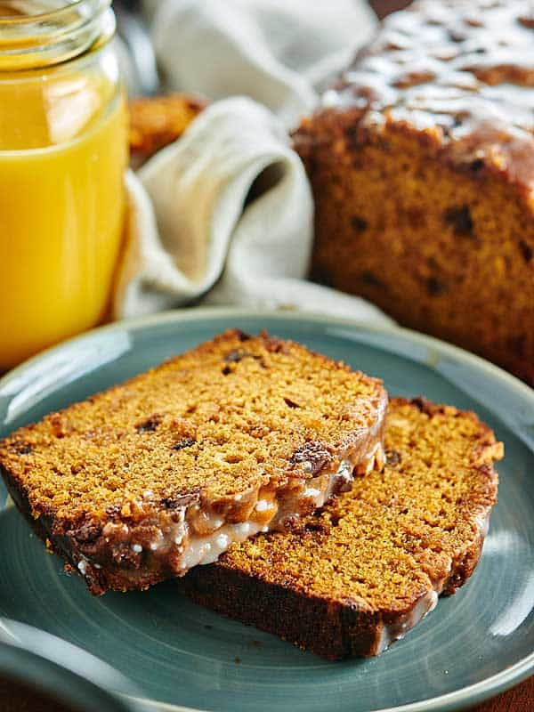 This Pumpkin Bread Recipe is studded w/ chocolate chips, butterscotch chips, & is so moist & easy! It tastes like fall. It can also be made into muffins! showmetheyummy.com #pumpkin #bread