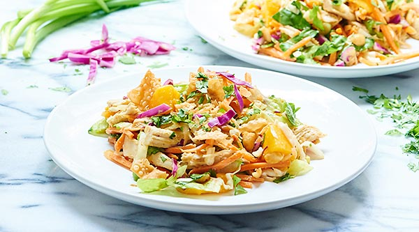 Bring this Thai Chicken Salad to work & you'll have the best lunch there. With so many great textures, fresh flavors, & tangy dressing, you'll never get bored! showmetheyummy.com #salad #healthy