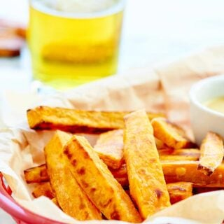 These Baked Sweet Potato Fries are sweet, salty, crispy, and fluffy! These are served w/ 3 sauces: honey mustard, brown sugar marshmallow, & maple vanilla! showmetheyummy.com #sweetpotato #fries