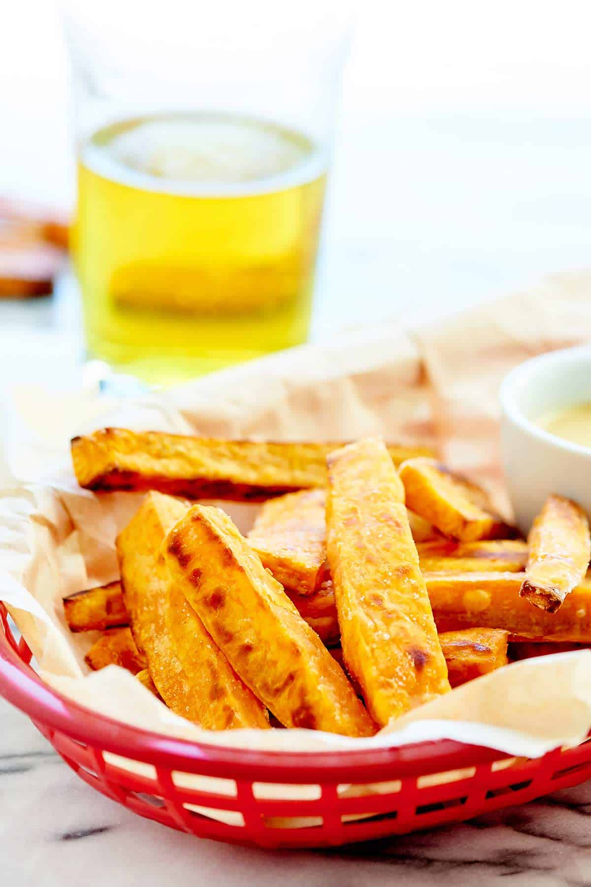 Baked sweet potato fries in basket