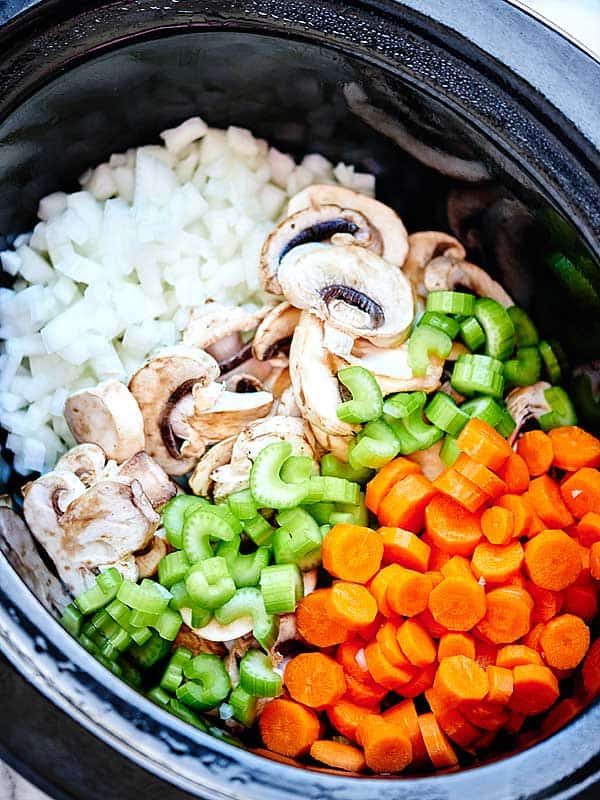 onions, mushroom, celery, and carrots in crockpot