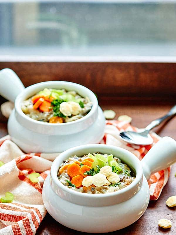This Crockpot Chicken Wild Rice Soup is such an easy recipe! It's also healthy, full of tender vegetables, seasoned with rosemary and thyme, and made creamy with non fat plain greek yogurt! showmetheyummy.com #crockpot #soup