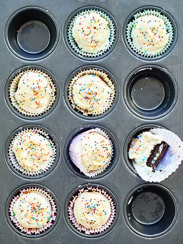 funfetti cheesecake cupcakes in muffin tin above