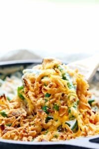 This is the BEST Green Bean Casserole Recipe. It's creamy and full of bacon, mushrooms, cheddar cheese, and French-Fried Onion Rings! The perfect side dish. showmetheyummy.com #bacon #greenbeancasserole