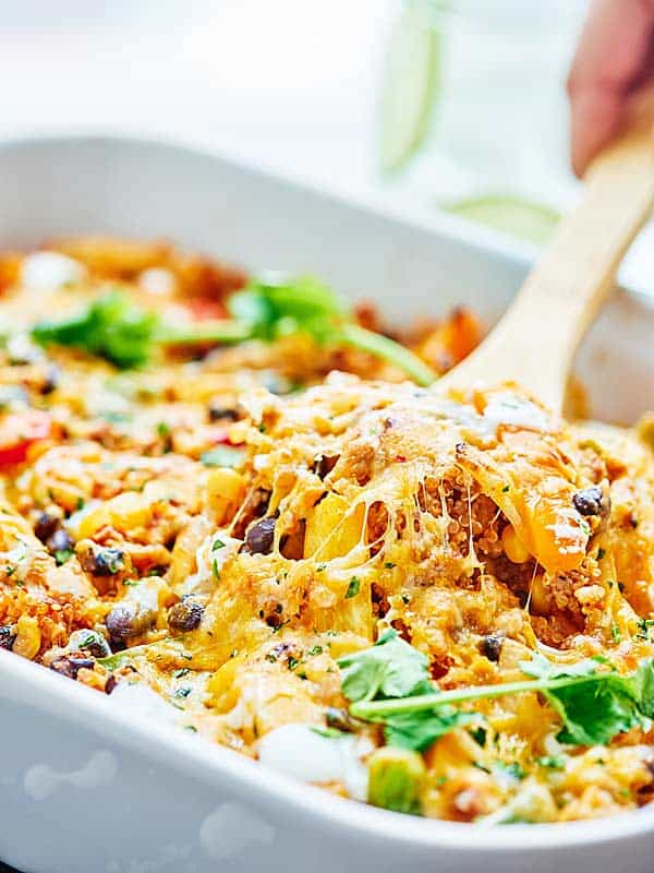 This Healthy Mexican Casserole is full of good for you ingredients like ground turkey, quinoa, black beans & bell peppers! Healthy Mexican food? Yes please! showmetheyummy.com #mexican #healthy