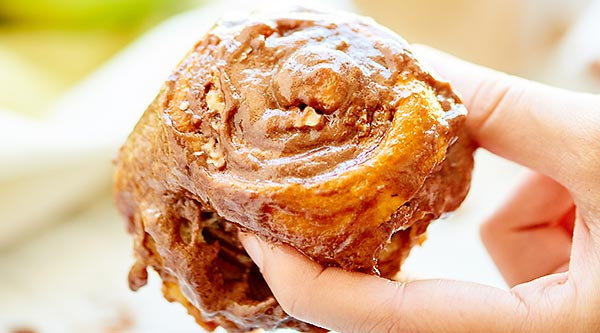 These Nutella Cinnamon Rolls are kept simple by using Pillsbury Dough Sheets, but are filled with 3 separate fillings: pecan, apple, and pumpkin and topped with the creamiest Nutella frosting! showmetheyummy.com #nutella #cinnamonrolls