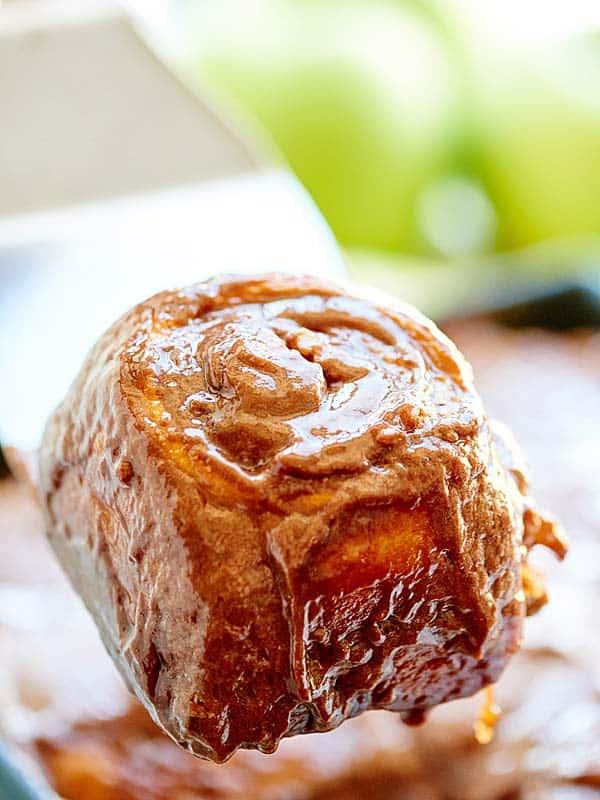 nutella cinnamon roll held on spatula
