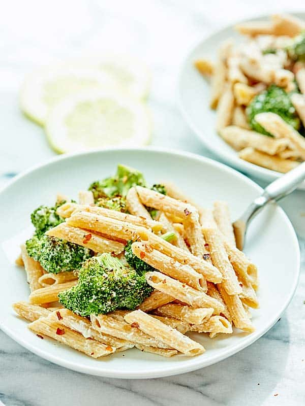 This Vegan Alfredo with Broccoli is made with a healthy cauliflower sauce, roasted broccoli, and whole wheat penne pasta! Cozy, healthy food at it's finest! showmetheyummy.com #pasta #vegan