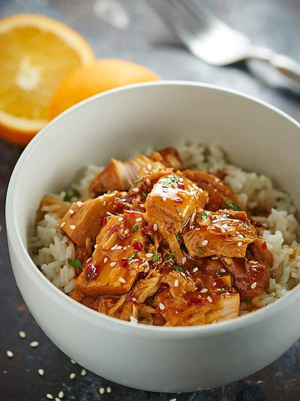 This Crockpot Orange Chicken is better than take out! It tastes better, is so much healthier, and is ridiculously easy to make. Orange chicken for the win! showmetheyummy.com #crockpot #orangechicken