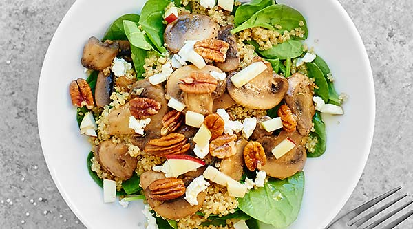 This Warm Mushroom Quinoa Salad is full of mushrooms and quinoa, spinach, goat cheese, pecans, and is smothered in a honey and apple cider vinegar dressing! showmetheyummy.com #quinoa #salad