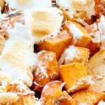This unique sweet potato casserole is full of roasted sweet potatoes, cashews, coconut, and marshmallows and is smothered in a brown sugar, cinnamon, butter sauce! showmetheyummy.com #thanksgiving #sweetpotatocasserole