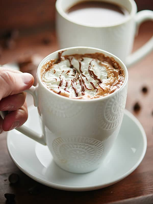 This Crockpot Nutella Hot Chocolate only takes 5 minutes to prep and 2 hours to cook! It's the easiest recipe you'll ever make and is full of nutella! showmetheyummy.com #nutella #hotchocolate