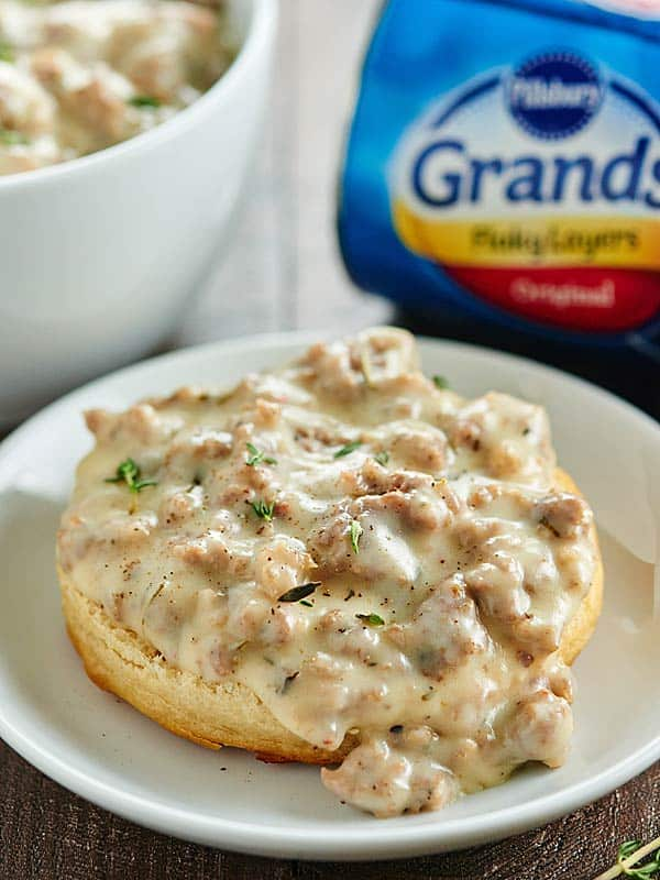 This Easy Biscuits and Gravy recipe is a great, cozy recipe for breakfast or dinner! Pillsbury Grands! get smothered in the creamiest sausage gravy! :) showmetheyummy.com #warmtraditions #sponsored @generalmills @pillsbury