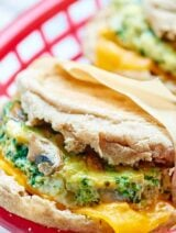 A healthy breakfast sandwich made of eggs, veggies, & optional turkey & cheese! Make these the day of or make them in advance & store in the freezer! showmetheyummy.com #healthy #breakfast #sandwich