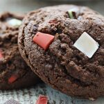 These Mint Chocolate Cookies are SO easy to make during the holiday season. A chocolate cookie is filled w/ both regular Andes Mints & Peppermint Crunch! showmetheyummy.com #mintchocolate #cookies
